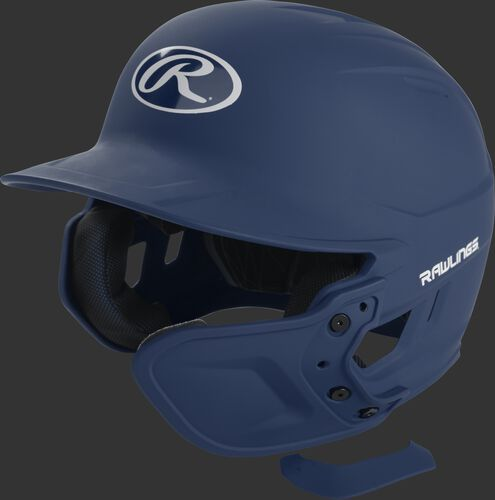 A matte navy MEXT attached to a Mach batting helmet showing the hardware