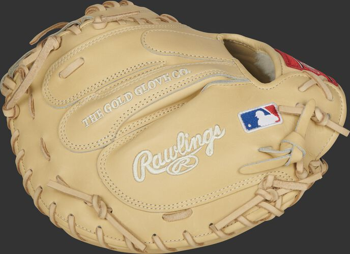 Side of a Pro Preferred camel catcher's mitt with the MLB logo on the wrist - SKU: PROSCM43C