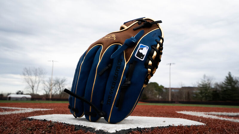 An exclusive HOH Wing Tip infield glove standing up on home plate on the finger tips - SKU: PRO204W-2TIR