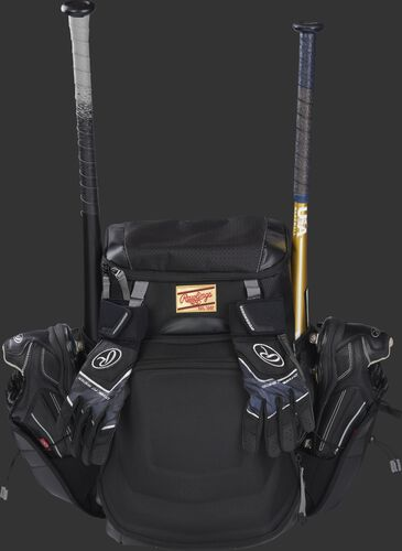 Front left of a black R1000 Gold Glove equipment bag filled with cleats and bats in the side compartments