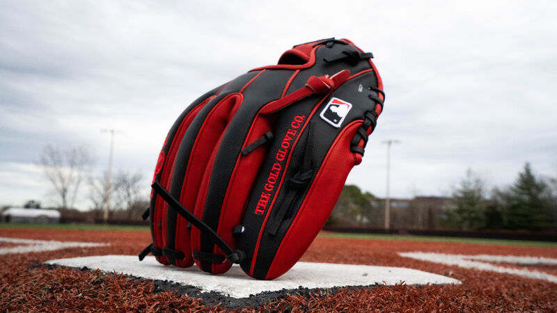 A Rawlings HOH Speed Shell glove standing on its fingertips on home plate - SKU: PRO315-2SSS