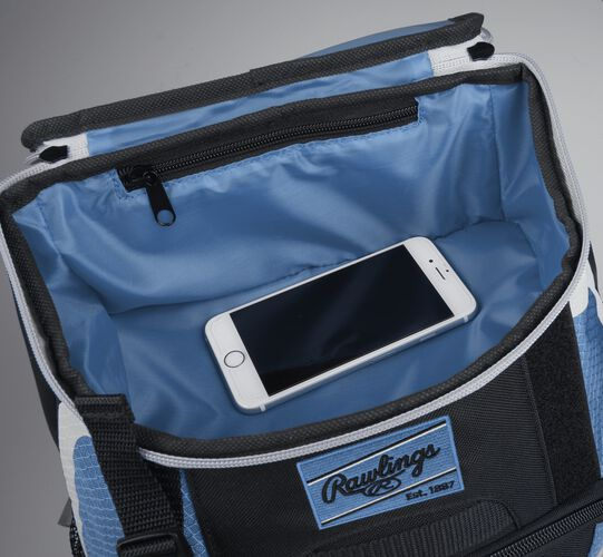 Top accessory pocket of a black/columbia blue R500 equipment backpack holding a phone