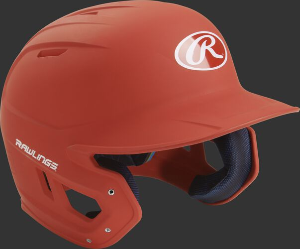 Right angle view of a matte MACH batting helmet with a burnt orange shell