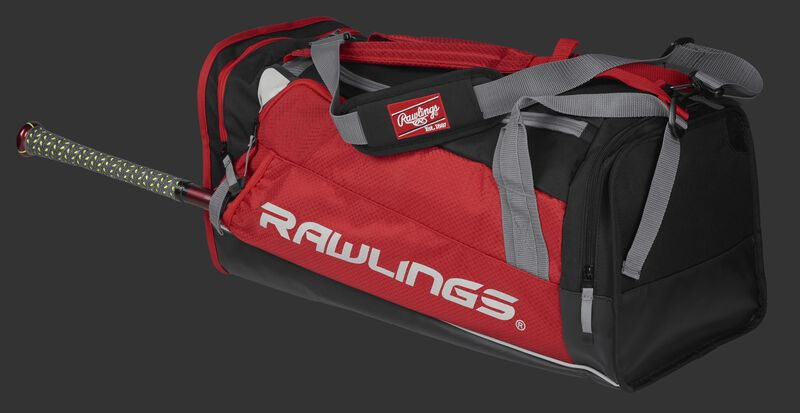Side angle view of a scarlet R601 Hybrid players duffel bag with a bat in the side sleeve