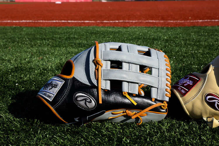 A Heart of the Hide ColorSync 5.0 13-Inch outfield glove on a field - SKU: PRO3030-6GC