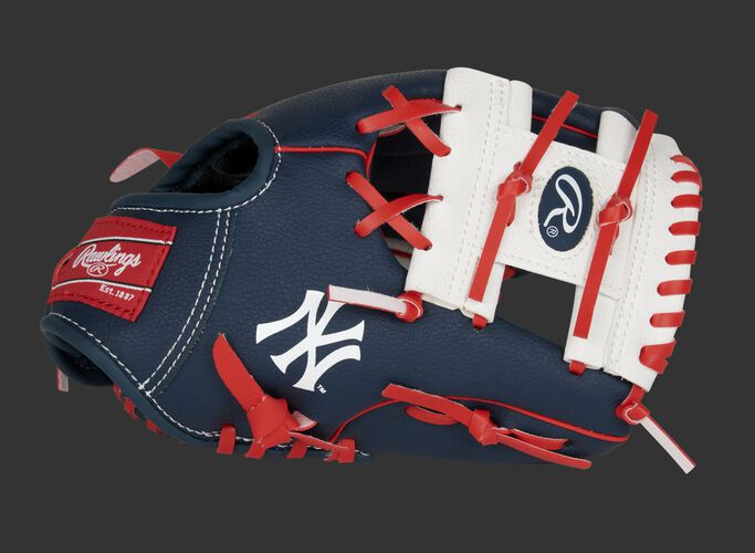 "A navy, white & red New York Yankees 10-inch team logo glove with a white I-web and ""NY"" logo on the thumb - SKU: 22000030111"
