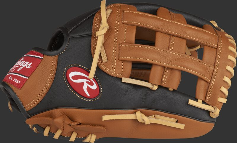 Thumb view of a P120GBH 12-inch Prodigy youth outfield glove with a black thumb, golden brown trim and golden brown H web