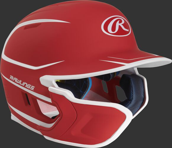 Right angle view of a matte scarlet/white MACHEXTR Mach Junior helmet with Mach EXT left hand batter face guard extension