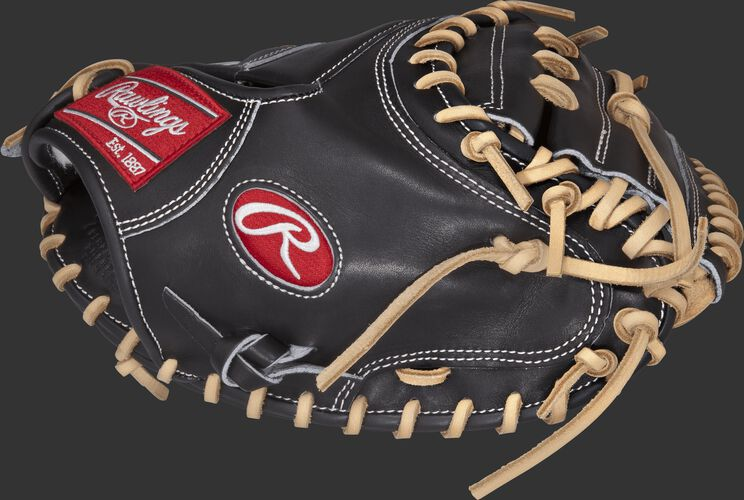 Thumb view of a black PROSCM33B Pro Preferred 33-inch catcher's mitt with a black one-piece solid web
