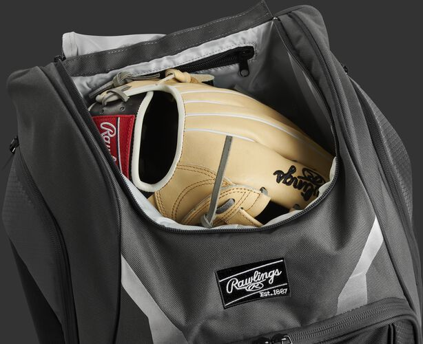 A glove in the dedicated glove storage pocket of a Rawlings Legion equipment backpack - SKU: LEGION-GR
