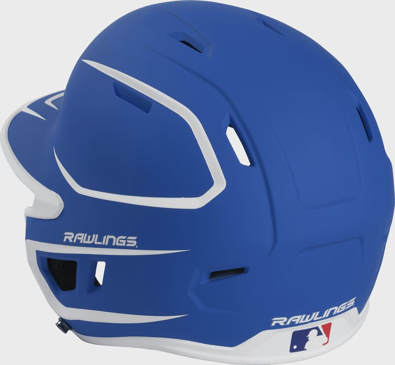 Back left view of a matte royal/white MACHEXTR MACH series two-tone batting helmet with air vents