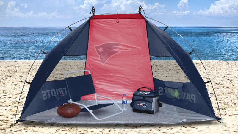 A New England Patriots sun shelter set up on a beach with a chair, football, cooler and water bottle - SKU: 00961076111