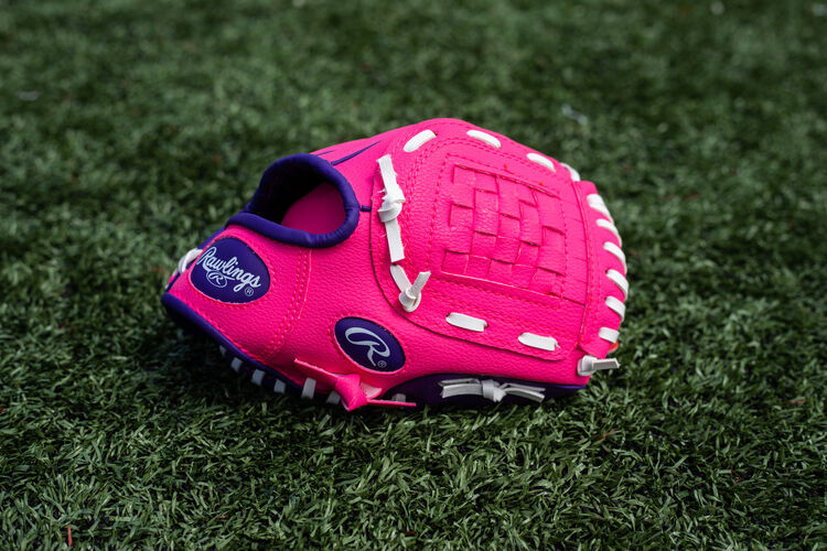 A pink/purple Players Series youth Basket Web glove lying on a field - SKU: PL91PP