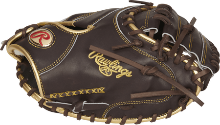 Thumb view of a mocha RGGCM43MO 34-inch Rawlings Gold Glove catcher's mitt with a mocha one-piece solid web