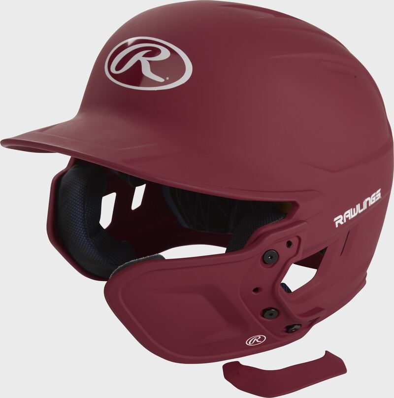 A matte cardinal MEXT attached to a Mach batting helmet showing the hardware