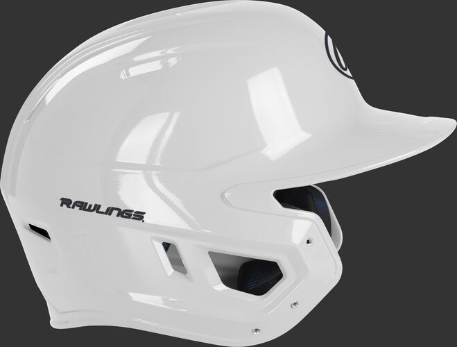 Right side of a MCH01A Rawlings Mach helmet with a white shell and compatible with a MEXT face guard extension