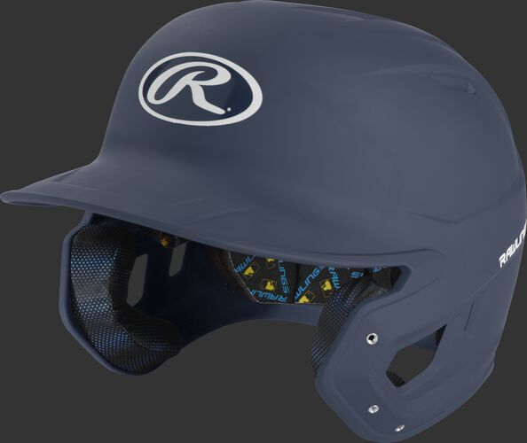 Left angle view of a matte navy MCH07A Mach high school/college batting helmet