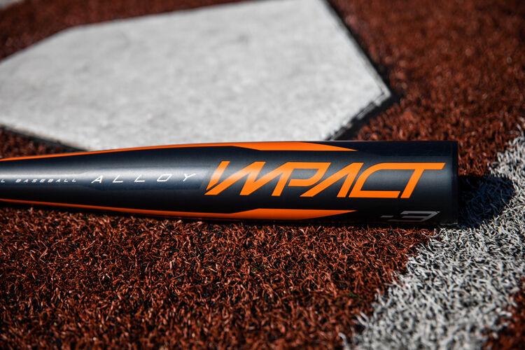 Barrel of a BBCOR Impact bat lying beside home plate - SKU: BBZI3
