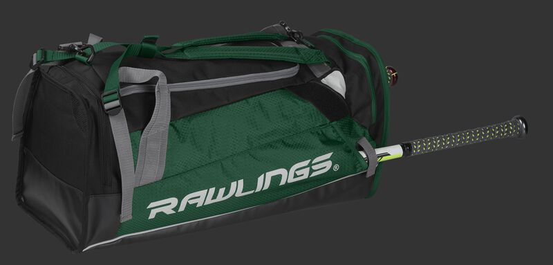 Side angle view of a dark green R601 Rawlings Hybrid backpack/duffel bag with a bat in the side compartment