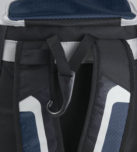 Exterior handle on the back of a black/navy R500 backpack with a hook for hanging it up