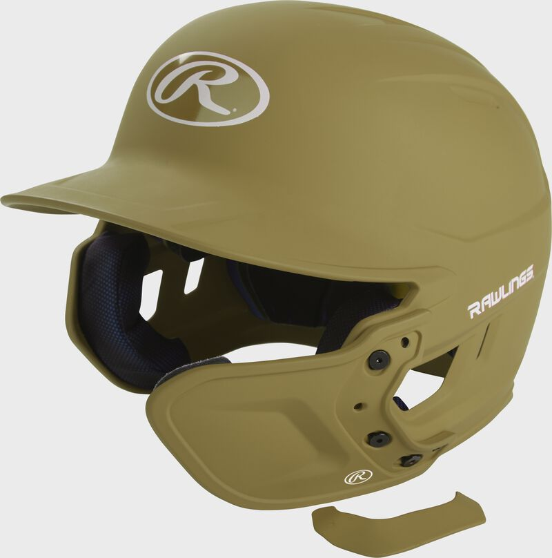 A matte Vegas gold MEXT attached to a Mach batting helmet showing the hardware