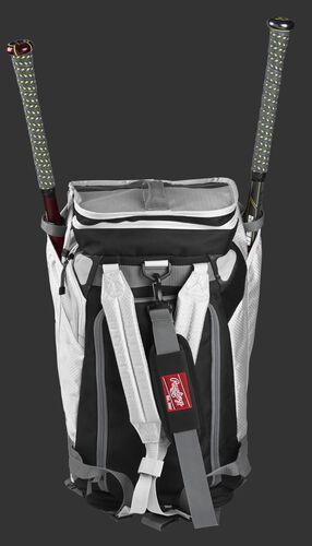 A white R601 Rawlings Hybrid duffel/backpack standing up with two bats