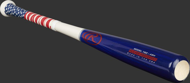 Angled view of a Player Preferred youth ash bat with a red, white and blue design and cupped end - SKU: Y62AUS