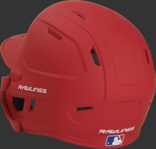 Back left view of a matte scarlet MACHEXTR MACH series batting helmet with air vents