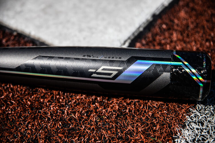 A -5 Velo ACP bat lying next to home plate - SKU: USZV5