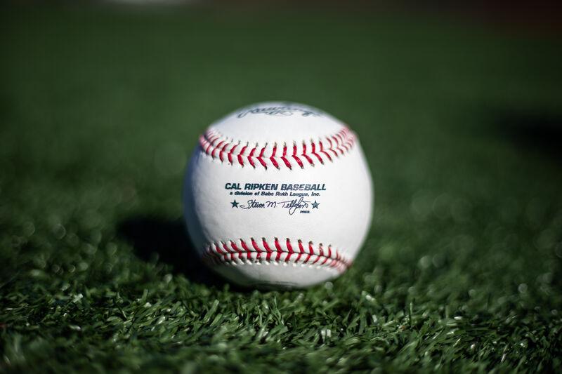 A Cal Ripken league baseball lying in the grass on a field - SKU: RCAL1