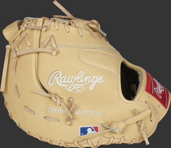 Side of a Rawlings Pro Preferred camel first base mitt with the MLB logo on the pinkie - SKU: PROSDCTCC