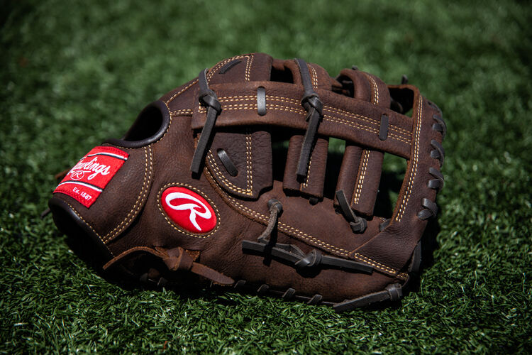 A Player Preferred first base mitt lying on a field - SKU: PFBDCT