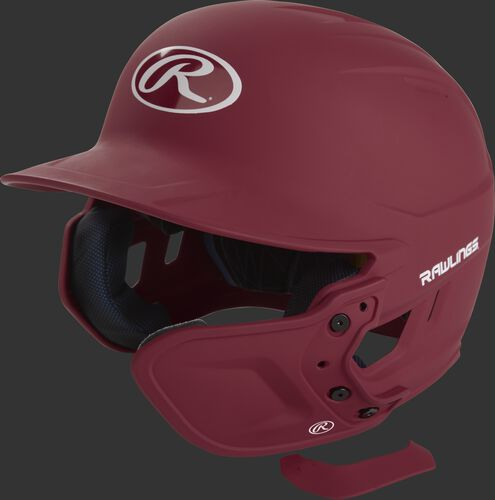 A cardinal MEXTR attached to a Mach batting helmet with the removable TPU piece off to show the hardware