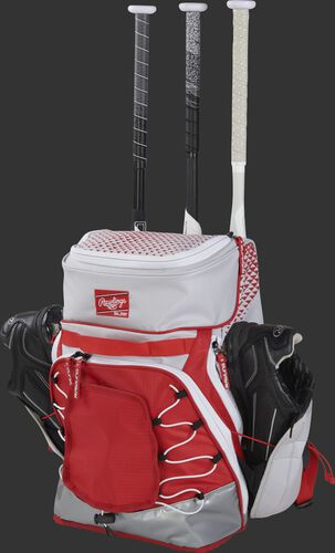 R800 Rawlings softball bag with a white/scarlet design and holding shoes and bats in the external storage compartments