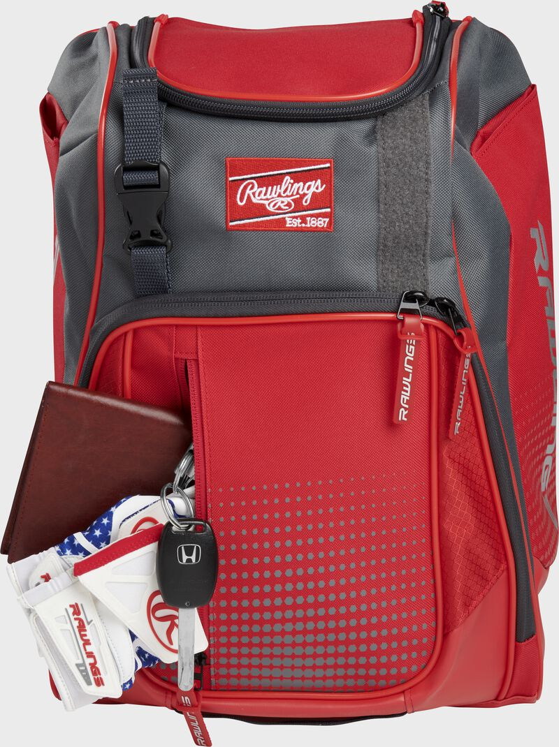 Wallet, keys, and batting gloves in the front valuables pocket of a scarlet Franchise baseball bag - SKU: FRANBP-S