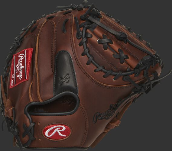 PROSCM20JTXRDP 32.5-inch Heart of the Hide catcher's mitt with a black finger pad on the timberglaze back
