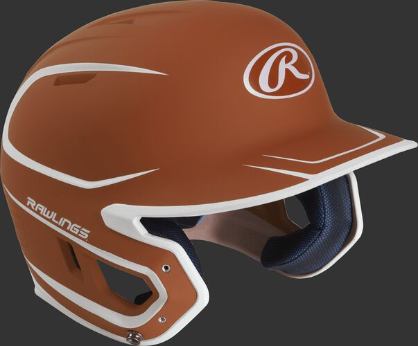 Right angle view of a matte MACH Senior batting helmet with an orange/white shell