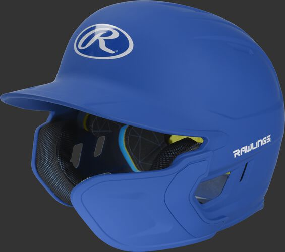 Left angle view of a matte royal MACHEXTR Mach Senior helmet with Mach EXT right hand batter face guard extension