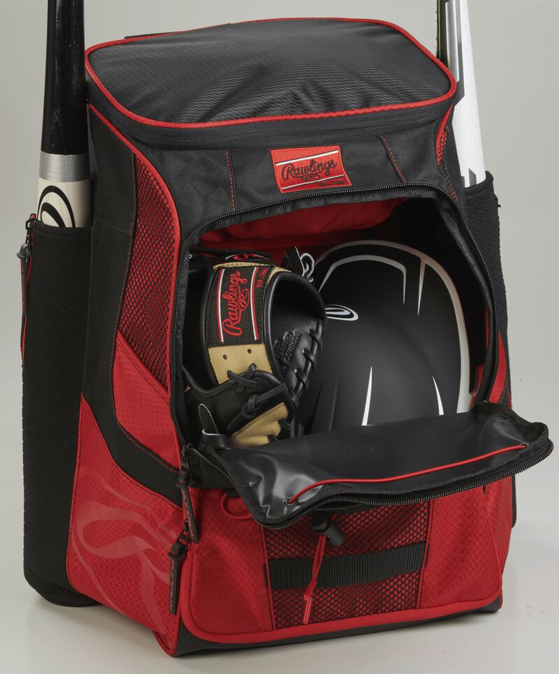 The main compartment of a scarlet/black R600 players team equipment backpack with a glove and helmet