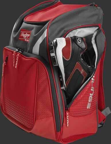 A cleat in the side cleat pocket of a scarlet Legion baseball backpack - SKU: LEGION-S