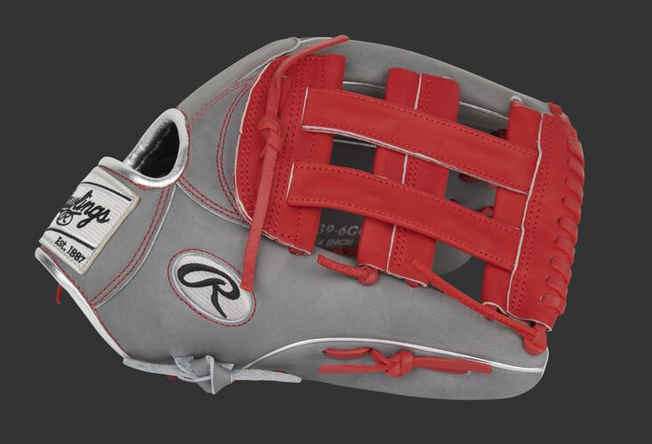 Thumb of a gray/scarlet exclusive Heart of the Hide Hyper Shell outfield glove with a scarlet H-web - SKU: PRO3039-6GCFS