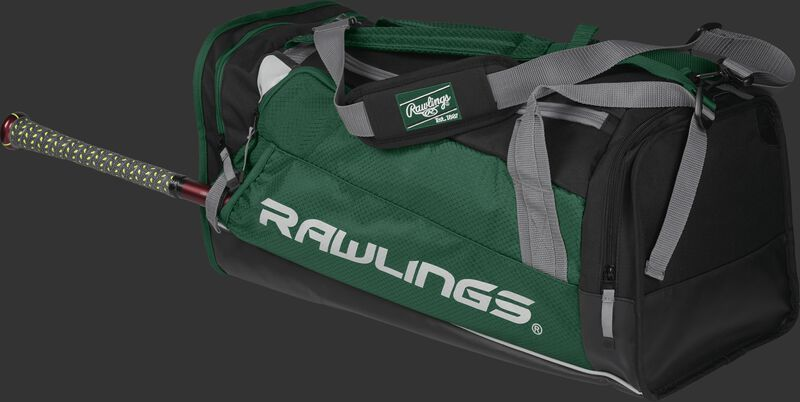 Side angle view of a dark green R601 Hybrid players duffel bag with a bat in the side sleeve