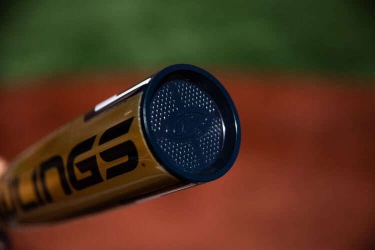 Navy end cap of a Rawlings Threat USA bat with a field in the background - SKU: USZT12