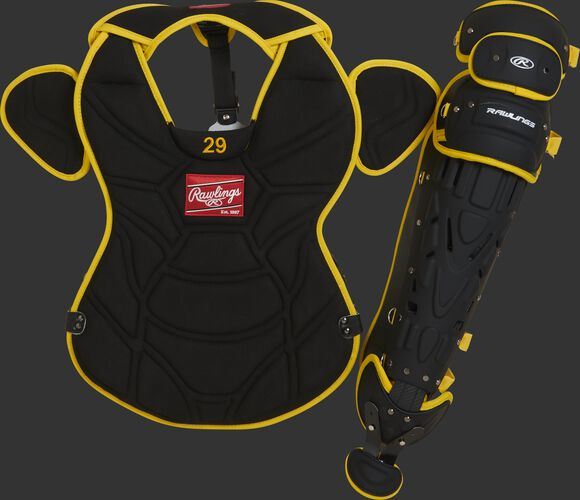 A black/yellow pro model chest protector and matte black leg guard with yellow accents