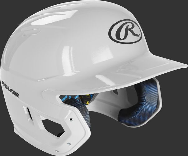 Right angle view of a MCH01A Rawlings Mach helmet with a white shell