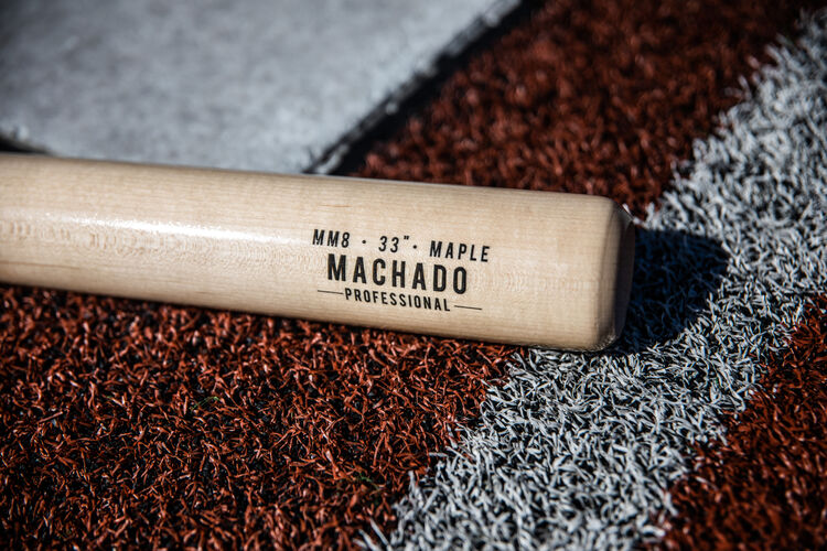 Natural barrel of a Manny Machado Pro Label bat lying on a field - SKU: MM8PL