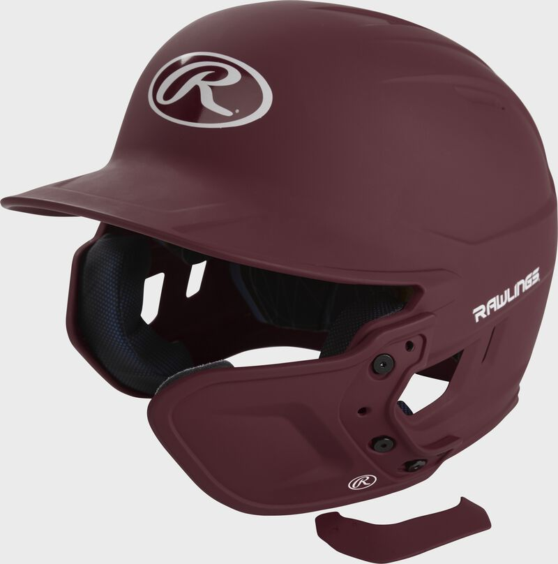 A matte maroon MEXT attached to a Mach batting helmet showing the hardware