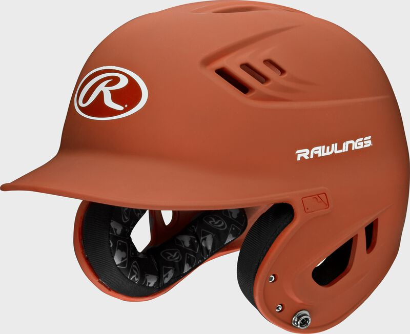 A burnt orange R16M Velo batting helmet with Cool-Flo vents