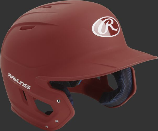 Right angle view of a matte MACH batting helmet with a cardinal shell