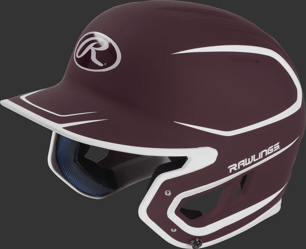 Left angle view of a Rawlings MACH Senior helmet with a two-tone matte maroon/white shell